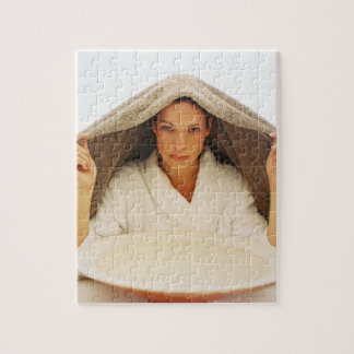portrait of a young woman with a towel over her puzzle