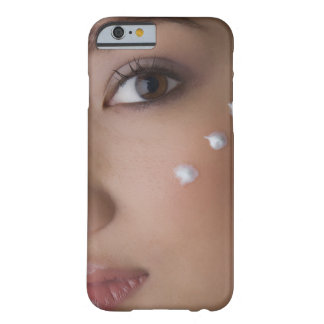Portrait of a young woman with cream on her barely there iPhone 6 case