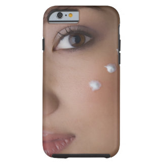 Portrait of a young woman with cream on her tough iPhone 6 case