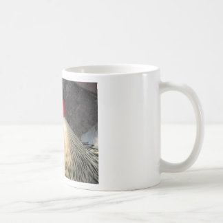 Portrait of an adult rooster on the poultry yard coffee mug