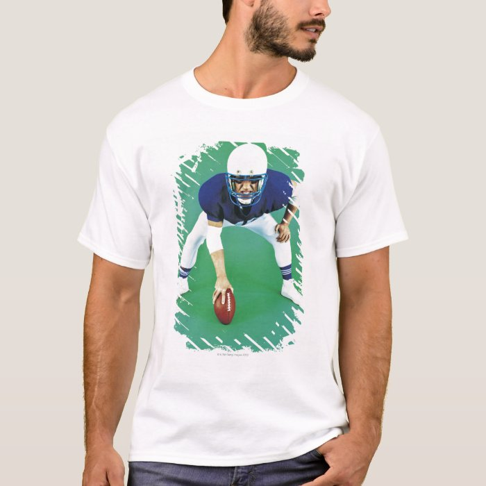 Portrait of An American Football Player Holding T-Shirt