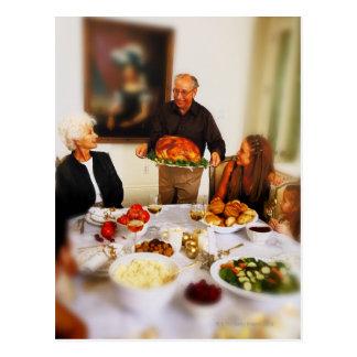 portrait of an elderly man holding a roast postcard