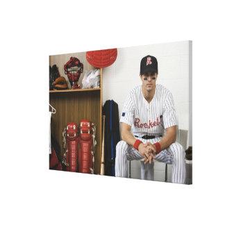 Portrait of baseball player sitting in locker canvas print