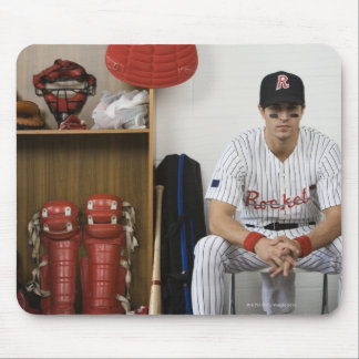 Portrait of baseball player sitting in locker mouse pad