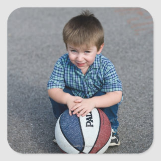 Portrait of boy with basketball outdoors stickers