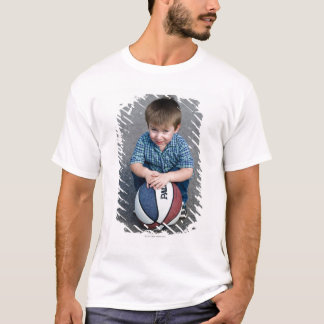 Portrait of boy with basketball outdoors T-Shirt