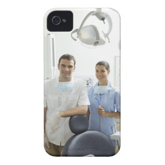 Portrait of dentist and his assistant in a iPhone 4 cover