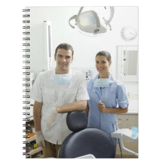 Portrait of dentist and his assistant in a notebook