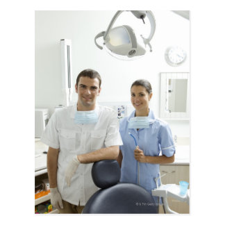 Portrait of dentist and his assistant in a postcard