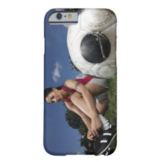 portrait of female football player tying her barely there iPhone 6 case