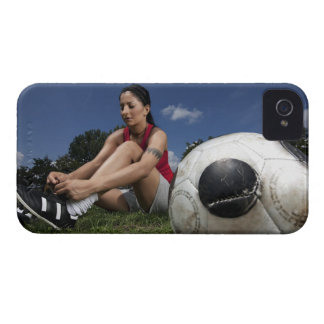 portrait of female football player tying her iPhone 4 Case-Mate case