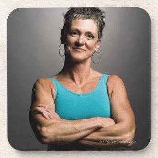 Portrait of fit woman drink coaster
