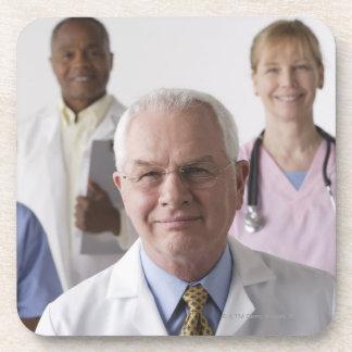 Portrait of four medical professionals, studio coaster