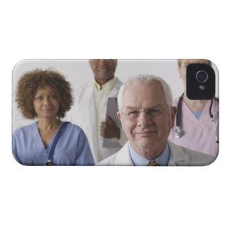 Portrait of four medical professionals, studio iPhone 4 case