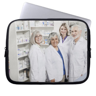 Portrait of four smiling pharmacists laptop computer sleeve