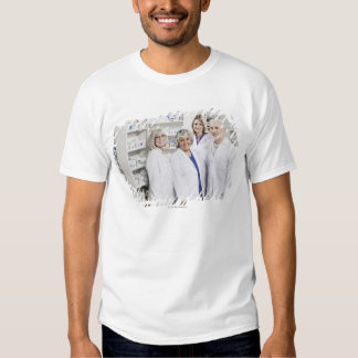 Portrait of four smiling pharmacists shirt
