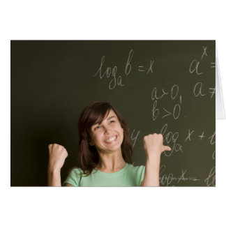 portrait of happy female student in front of card