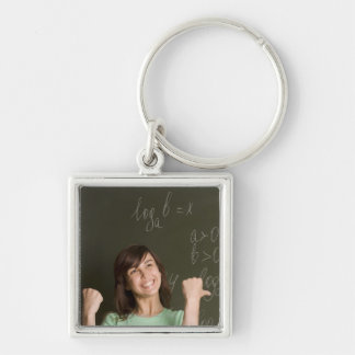 portrait of happy female student in front of keychain