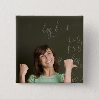 portrait of happy female student in front of pinback button