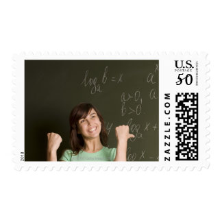 portrait of happy female student in front of postage