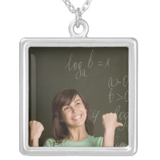portrait of happy female student in front of silver plated necklace