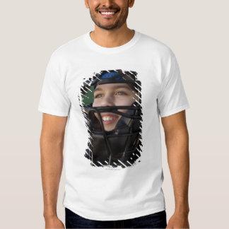 Portrait of little league catcher in mask tee shirt