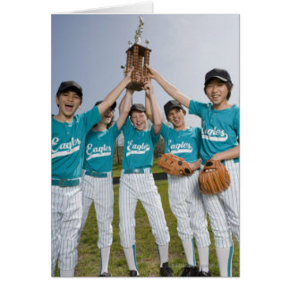 Portrait of little league players with trophy card