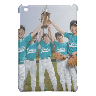 Portrait of little league players with trophy cover for the iPad mini