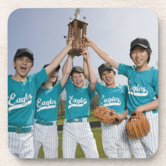 Portrait of little league players with trophy drink coaster
