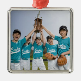Portrait of little league players with trophy metal ornament