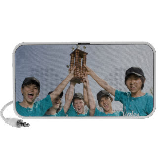 Portrait of little league players with trophy travelling speakers
