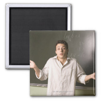 portrait of male student in front of blackboard 2 inch square magnet