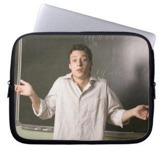 portrait of male student in front of blackboard computer sleeves