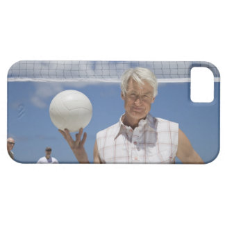 Portrait of mature man holding volley ball on iPhone 5 cases