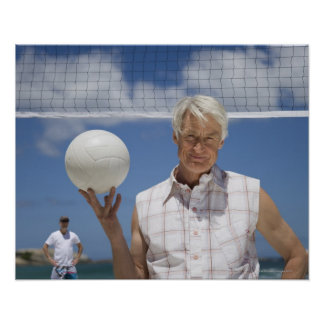 Portrait of mature man holding volley ball on poster