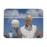 Portrait of mature man holding volley ball on flexible magnets