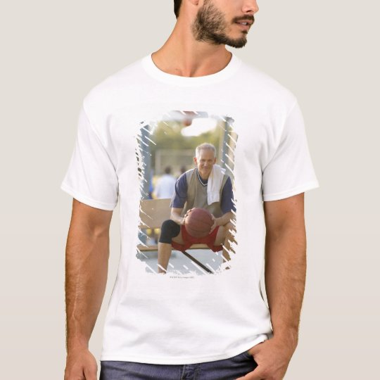 Portrait of mature man with basketball sitting T-Shirt