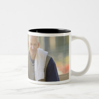 Portrait of mature man with basketball sitting Two-Tone coffee mug