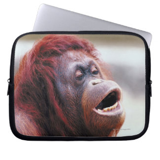 Portrait of orangutan computer sleeves