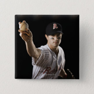 Portrait of pitcher throwing baseball button