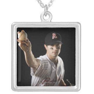 Portrait of pitcher throwing baseball pendant