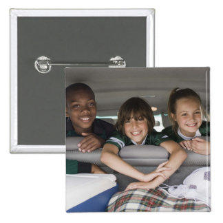 Portrait of smiling children in car pinback button