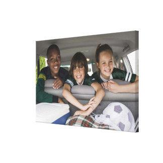 Portrait of smiling children in car canvas print
