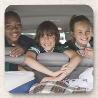 Portrait of smiling children in car drink coaster