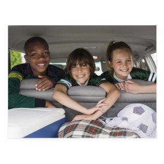 Portrait of smiling children in car postcard