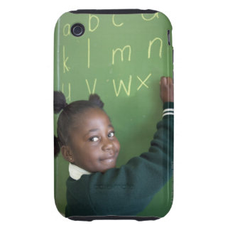 Portrait of smiling schoolgirl writing on the tough iPhone 3 covers