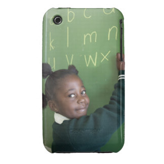 Portrait of smiling schoolgirl writing on the iPhone 3 cover