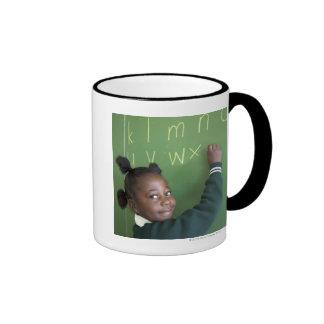 Portrait of smiling schoolgirl writing on the ringer coffee mug