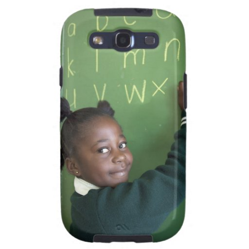Portrait of smiling schoolgirl writing on the samsung galaxy s3 case