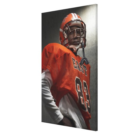 Portrait of teenage (14-15) American football Gallery Wrapped Canvas